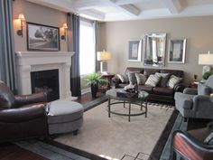 Comfy and cozy living room.  I love the detail in the ceiling and the tall windows flanking the fireplace.  In a perfect world, I would wall-mount a TV above the fireplace!  Photo taken at a Mattamy show home in the Half Moon Bay community in Barrhaven.