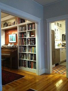 (2) bookcases, and upper shelving built in around piano.