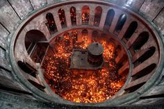 An aerial view from the rotunda inside the Church of the Holy Sepulchre in Jerusalem that shows the Tomb of Christ as the miracle of the Holy Fire occurs the day before Easter.  April 2011