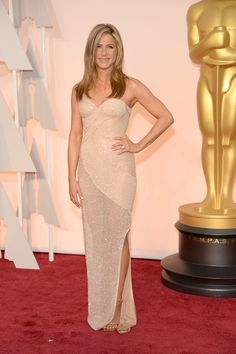 Jennifer Aniston on the red carpet at the 87th Academy Awards.