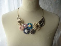 statement bib necklace with fabric flowers and metal bronze leaves. $15.00, via Etsy.