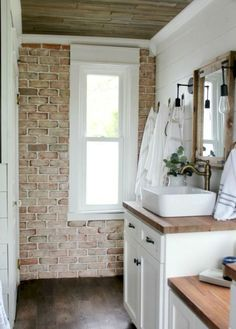 Vintage Inspired Farmhouse Bathroom Makeover 2019 Brick wall in bathroom love the white cabinets and butcher block countertops wood ceiling shiplap walls The post Vintage Inspired Farmhouse Bathroom Makeover 2019 appeared first on House ideas. Modern Farmhouse Bathroom, Bathroom Inspiration, Sweet Home, Farmhouse Bathroom Decor, Bathrooms Remodel, New Homes, Home Decor, House Interior, Bathroom Design