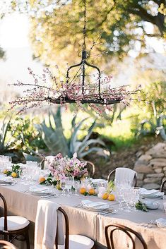 30 Cheap Wedding Decorations Which Look Chic ❤ cheap wedding decorations over the table decoration with branches of flowering pink flowers braedon flynn via instagram ❤ See more: http://www.weddingforward.com/cheap-wedding-decorations/ #wedding #bride #weddingdecor #weddingdecorations #cheapweddingdecorations