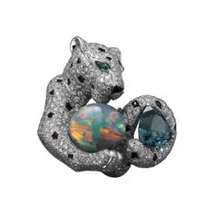 Panthère de Cartier High Jewelry ring White gold, one 3.59-carat indigolite tourmaline, one cabochon-cut opal, onyx, sapphire spots, emerald eyes, brilliants.