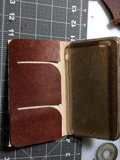 Leather iPhone 6 Plus case with slots for credit or business cards.