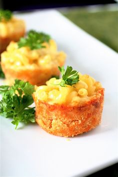 Mac 'n Cheese. Adorable!  **Baked these in a demarle mini muffin pan & surved at a BBQ to go with hot dogs etc. - they are super easy to eat and yummy, any baked mac & chz recipe would work.  :)