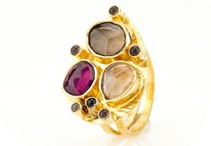 Capri Teardrop Ring (CIGARSQ)    A fabulous teardrop shaped ring with a trio of faceted citrine, rhodolite garnet and smoky quartz with accents of cabachon smoky quartz. This gorgeous statement ring is the perfect accessory for fall! 22k gold vermeil. Adjustable band.