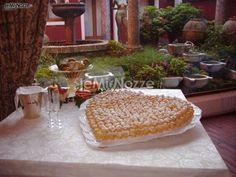 http://www.lemienozze.it/operatori-matrimonio/luoghi_per_il_ricevimento/ristorante-ricevimenti-treviso/media/foto/11  Torta nuziale a forma di cuore