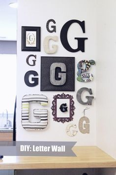 DIY Letter Wall - I always thought cross walls were pretty cool, but EVERYBODY had one.  But this... I like!  How original.  :)
