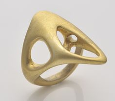 A beautiful plated silver ring, chic and feminine that has an abstract design which gives the impression of a sculpture. http://www.silvertownart.com/Gold_Sculpture_Ring_p/fi2205121.htm