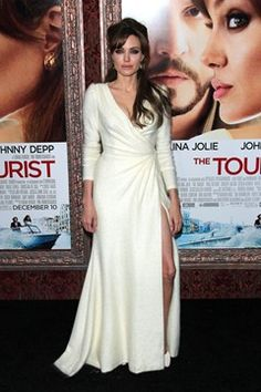December 2010  For the world premiere ofThe Touristin New York, she wore a long ivory Atelier Versace gown with a pair of green Beryl earrings from Robert Procop.