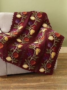colcha Free Crochet Pattern: Nature's Bounty Afghan.  Looks embroidered - great detail and rich colors!