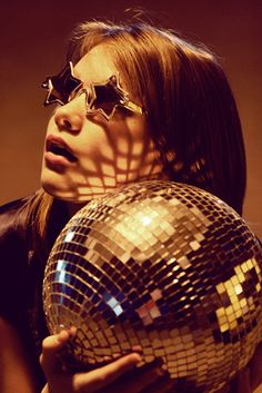 Stars in her eyes. | Star shaped shades and a disco ball. What more could a girl need on a Friday night?