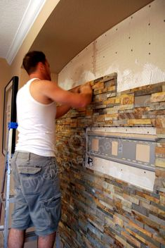 Flat Screen TV installed on Stacked Stone Wall - Installing Stone