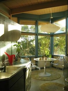 I love how the breakfast nook seems to almost merge aesthetically with the outdoors.