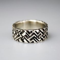 Geometric hand carved relief around the entire band that will keep your style in traction. Can be made to various widths. Band shown is 9mm wide by