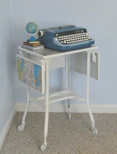 @Leslie Autumn - may be kicking myself right now for letting the typewriter stand go at the rummage sale!! darling idea of maps on this table!!