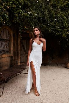 a8ea38dac10f7e Jaws will drop in the sexy White Layali gown. This dress features scalloped  lace detailing