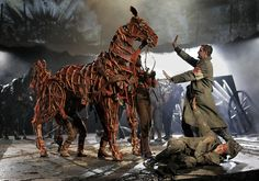 It is an image that has become the symbol of a bestselling book, an award-winning theatrical blockbuster and soon a film by Steven Spielberg. Every year, fans of War Horse, Michael Morpurgo's tale Peter Hermann, Michael Morpurgo, Theatre Reviews, National Theatre, Carousel Horses, Scenic Design, Stage Design, Theatre Design, Show Horses