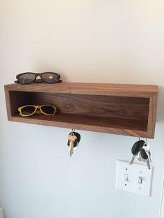 Floating Shelves with Magnetic Key Hooks - Solid Black Walnut by KrovelMade on Etsy https://www.etsy.com/ca/listing/235057634/floating-shelves-with-magnetic-key-hooks