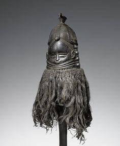 "Sierra Leone; Mende peoples Sowei (mask) 2nd quarter of the 20th century Wood, raffia H. 33 cm (13"")"