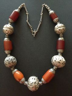 Yemen | Silver beads and 'amber' necklace.  The amber beads here are not real amber but an imitation ~ possibly bakelite | © Jose M. Pery