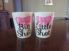 Big Shot Little Shot set of two white shot glasses with bow design. Great gift for sisters or sorority big little. $18.00 for the set. You can change bow colors and fonts.