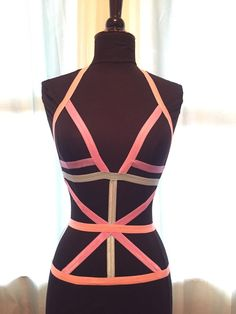 This creamy pastel harness is a lovely departure from the usual black or red! This multi colored piece features shades of light pink, Aqua