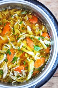 Instant Pot Chicken Noodle Soup - Tender chunks of chicken in a rich homemade chicken broth with big hearty veggies. Homemade Instant Pot chicken noodle soup from scratch in less than an hour.