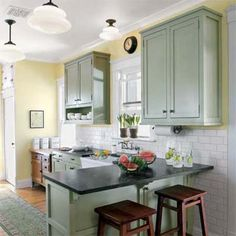 Borrowing from the pages of This Old House, these budget-conscious DIYers gave their nothing-special kitchen a better layout and a stylish new retro look. | Photo: J. Curtis | thisoldhouse.com