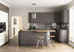 Dark grey matt kitchen in a modern & uncluttered slab style.
