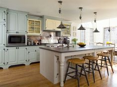 country modern kitchen idea....don't love the stools, and I would want darker flooring.