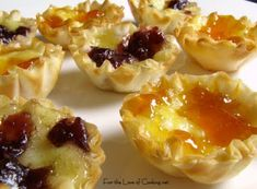 Brie Bites- small cuts of brie in mini phyllo shells topped with rasberry or apricot jam baked till brie is melted and phyllo shells are crispy golden brown... Christmas or thanksgiving appetizer!