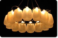 Alexander Reh took 14 gallon-sized milk jugs, a hula hoop and some string lights and created this amazing outdoor chandelier. His site doesn't give a full tutorial, but clicking through the pix giv...