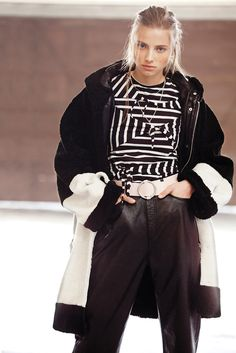 AALTO's sheepskin parka with Cheap Monday's cotton jersey T-shirt and leather pants. Belt by Marimekko; earrings by 1-100. [Photo by Franck Mura]