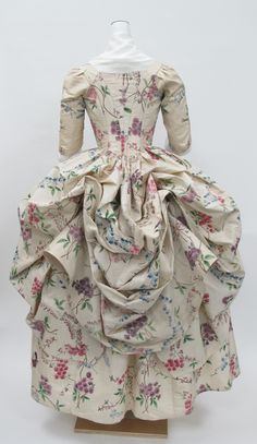 <P>The polonaise gown first came into fashion in the 1770s. It was a style of gown with a close-fitting bodice and the back of the skirt gathered up into three separate puffed sections to reveal the petticoat below
