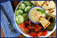 Greek mezze platter: would also be good with a piece of feta marinated with toasted pinenuts, and olives