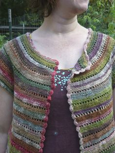 Ravelry: hodgepodge's Cap-Sleeve Cardigan.  Normally I like shoulder seams but this is so pretty.