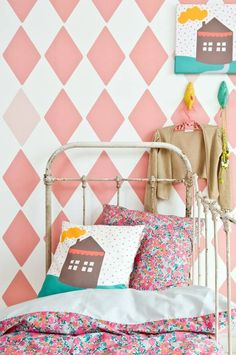 Kids room: pink diamond pattern accent wall
