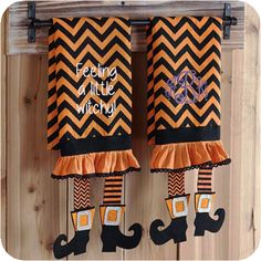 "Witch's Legs Tea Towel These adorable tea towels will add some Halloween whimsy to your kitchen or bathroom. Perfect for monogramming! The chevron tea towel features adorable dangling felt witch's legs. Measures 14"" x 21"" Towel is cotton - Witch's Legs are Felt"