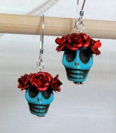 Dia de los Muertos Earrings - Turquoise Skull w/ Red Flowers. $10.00, via Etsy.