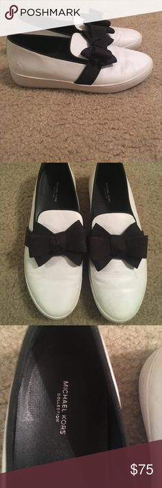 Michael Kors Val sneakers White leather bow sneakers size 40. Little dirty. Worn maybe 3 times KORS Michael Kors Shoes Flats & Loafers