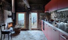 Switzerland house to rent: Rustic Alpine house in Switzerland with red kitchen