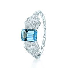 Tiffany & Co. -  Aquamarine Bow Bracelet: Archival sketches from the 1930s inspired this stylized bowtie bracelet set with an emerald-cut aquamarine and diamonds in platinum. Carat weight: aquamarine, 25.23. Carat total weight: round brilliant diamonds, 4.43; square diamonds, 1.02.
