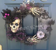 Hints of purple and silver fill this wreath! Hand painted skull with beautiful top hat on top! Sure to make your door extra spooky this year! **shipping for the low rate will be about 6 days, if you want it to arrive faster you will need to pay the extra that it cost for 2 day shipping**