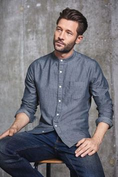 Whether a day in the office or night out with your mates, the grandad collar will always be a winner. Pair this Chambray Textured Grandad Shirt from Next with some dark wash jeans and you're good to go!