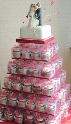 Guests cupcakes in a to go box (possibly with a thank you note and storie of wedding cake traditions attached)