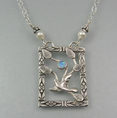 "Flying bird necklace with opal in sterling silver - ""Spread Your Wings Necklace"" handmade by Kryzia Kreations"