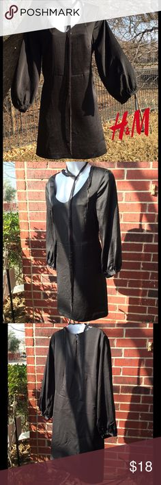Classic black H&M Dress with puffed sleeves Classic black H&M Dress with puffed sleeves.  Elastic at the end of sleeves.  Fabric is a Polyester, Rayon blend.  Machine wash.  Great pre-owned condition. H&M Dresses