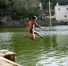 This image is shot at Banganga, which is a place in the Malabar Hill area of Mumbai City. It is believed that in mythical times the great Lord Rama, an incarnation of God Vishnu, shot an arrow in the ground to provide for fresh water for drinking. The place where the arrow hit the ground there issued out a stream of fresh and sweet water from a tributary of the Ganga, over a thousand miles away. Hence the place is known as Banganga    [Text courtesy wikipedia.org]